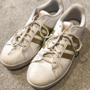 Adidas with gold stripe